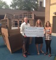 PCF's Vinnie Altamura presents check to Christ Preschool Director Sharon Fuller and Preschool Board Chair Jill Brooks.