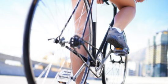 Cropped view of a female cyclist on her bicycle
