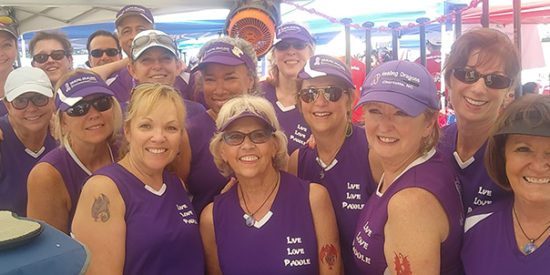 Healing Dragons try to beat cancer one paddle at a time.  Pam Boileaus, the president,  is third from right.