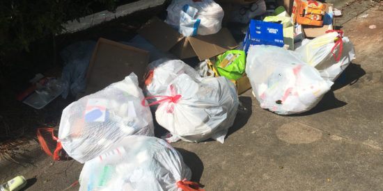 Trash continued to pile up over the weekend where dumpsters were removed and not replaced as the town switched waste service companies